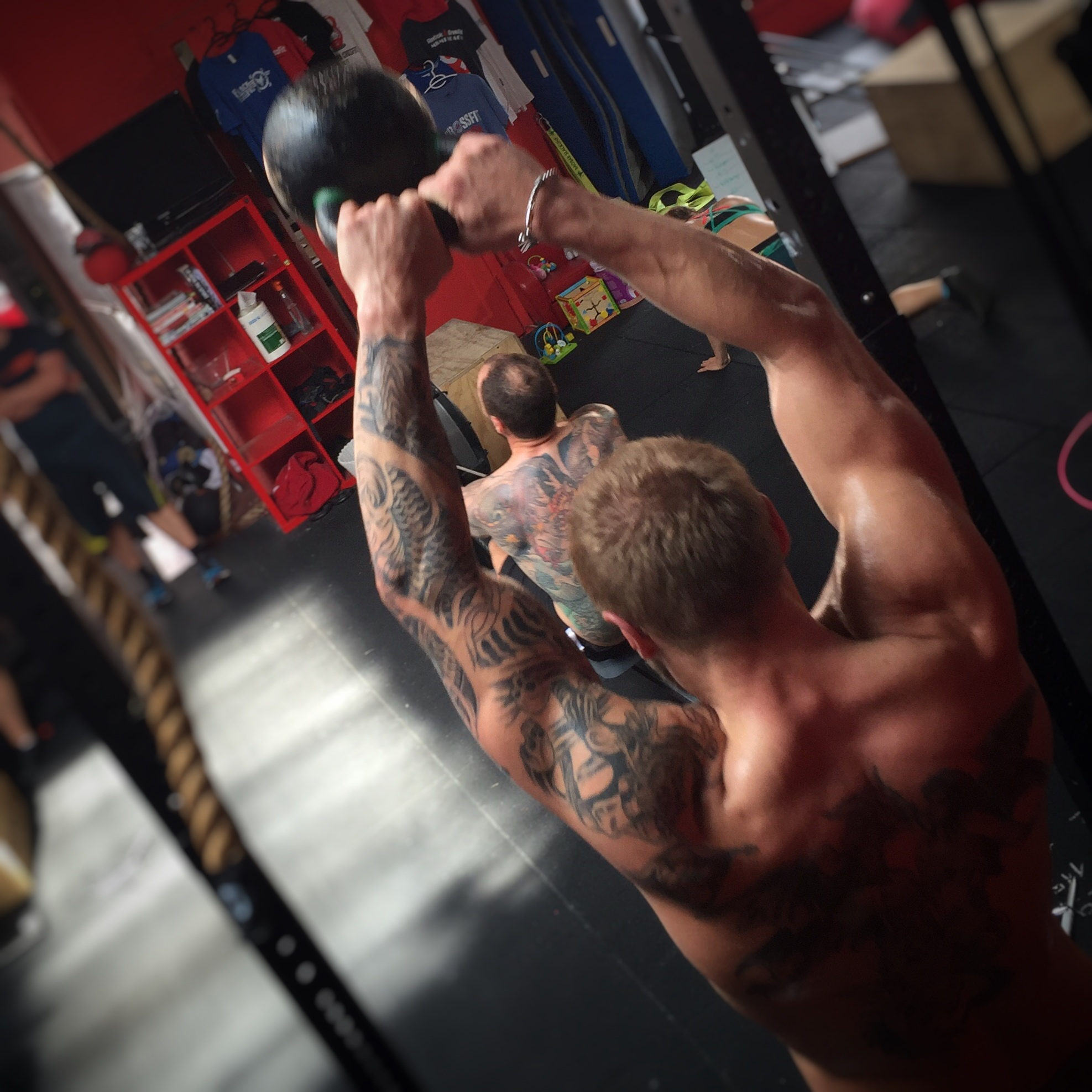 CrossFit Le Rouge Partner WOD box step ups kettlebell swings L-hold