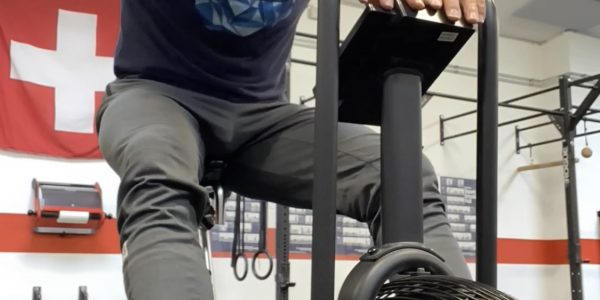 CrossFit WOD L-sit push-ups air-bike