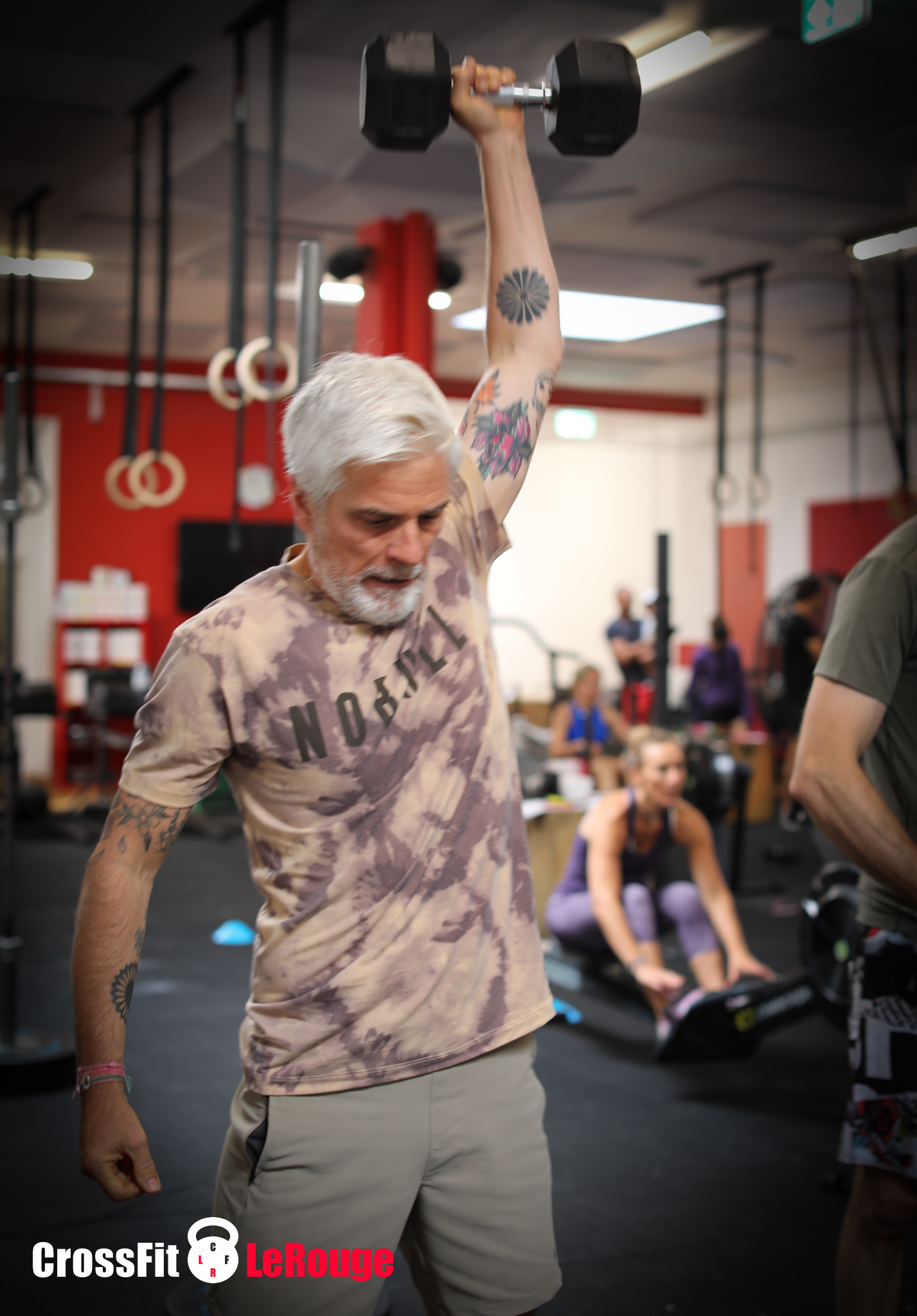 CrossFit team-WOD farmer-carry pull-ups power-snatches