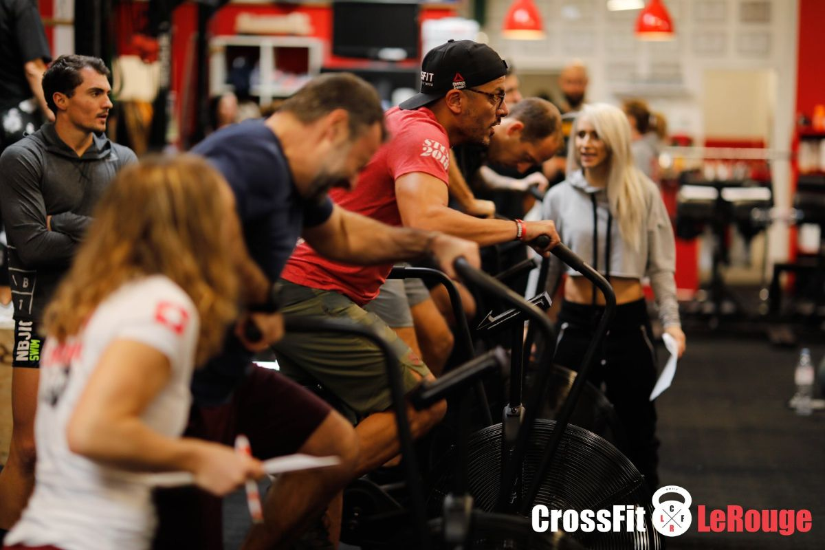 CrossFit team WOD Air-Bike push-ups pull-ups box-jumps